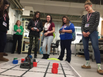 "A group of students from Salem High School learn how to maneuver robots during the ""Girls in Technology Day"" at Manchester Community College."