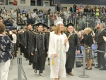 Class Marshal Deana Nicoletti leads in graduates of Manchester Community College, held at St. Anselm College's Sullivan Arena Wednesday.