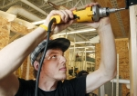 Seth Miller works on a shed during a building trades class