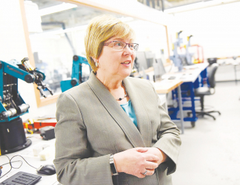 President Susan Huard speaks during a tour of the Robotics and Automation Lab at Manchester Community College on March 29.