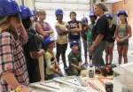 Elaine Hamel, director of Girls at Work, talks to girls about power tools safety.