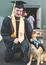 Jeremy Clague, a Marine Corp veteran from Hampstead with his dog Buddy during the Manchester Community College graduation ceremony held at Saint Anselm College in Goffstown on Wednesday.