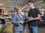 MCC President Susan Huard talks with a student in the college's automotive shop.