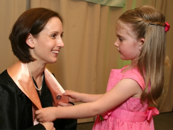 Alannah Doremus, 5, pins her mom, Victoria, during the Nurse Pinning Ceremony