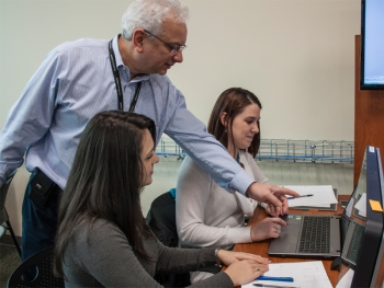 Peter La Monica, who heads Manchester Community College's new Cyber Security Investigations program, works with students.