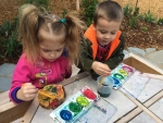Students at MCC's Child Development Center enjoy painting in their new outdoor classroom.